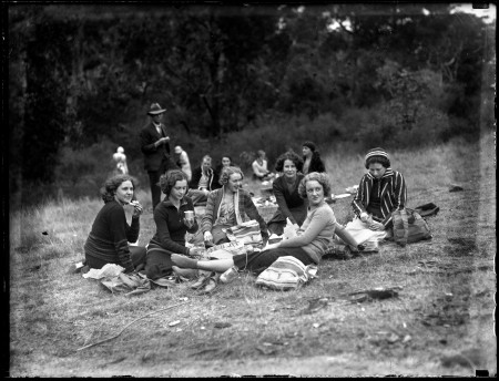 Black and white image of ladies in a park on a picnic
