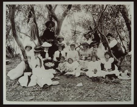 Group of people picnic among the trees in the 1890s