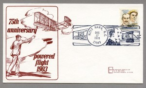 "Illustration with the Wright brother's plan text reads""75th Anniversary - Powered flight 1903"""