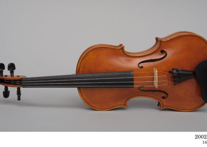 Violin lying on its side made by Harry Vatiliotis