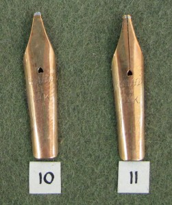 Close up of two gold nibs