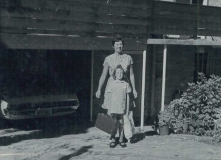 Nicky with her Mum off to school in 1971, photo taken in of a suburban house