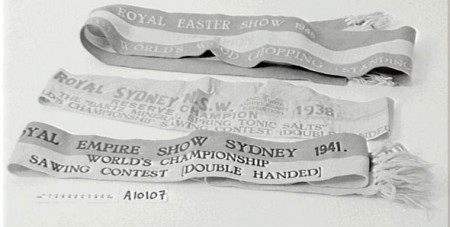 Three Royal Easter Show prize ribbons for wood chopping