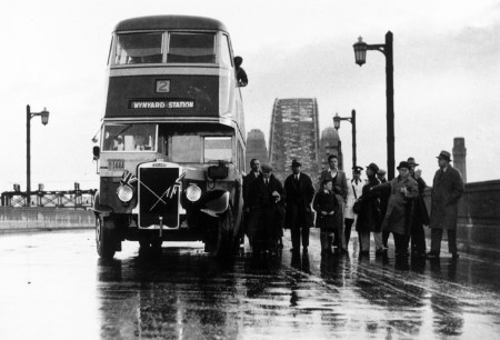 Black and white photo of the first NSW Government bus to cross Sydney Harbour Bridge in 1937
