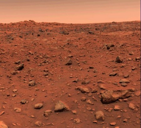 The first colour image from the surface of Mars taken by Viking 1. In the original processing of this image, the sky was assumed to be blue, but further processing and other images revealed the sky to be a 'pinkish-butterscotch' colour.