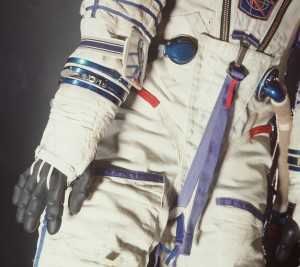Detail view of the Sokol spacesuit showing the wrist couplings for the detachable gloves and the mirror worn on the arm to assist the cosmonaut to see objects that would otherwise be outside the field of vision. Image Courtesy of Powerhouse Museum
