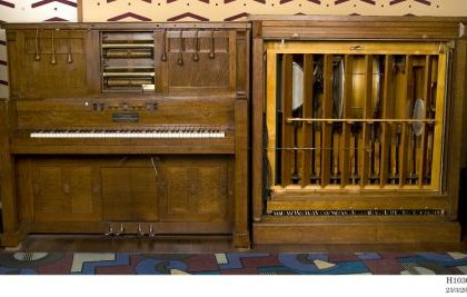 Photograph of piano and organ pipes