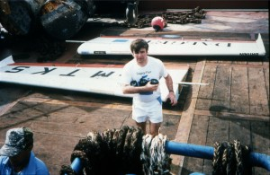 Brian Milton with the ultralight in pieces after rescue by the supply ship. Photo courtesy of Brian Milton.