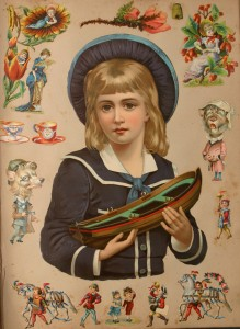 Victorian scrapbook with young girl holding toy
