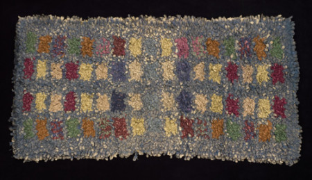 Rag rug made by tufting strips of material through a knitted string base, made by Elizabeth Nunn in Sydney, around 1939.  Powerhouse Museum collection. Gift of Grace Flinn, 1994. 94/179/1