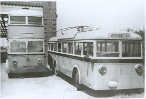 Photograph of single and double-deck trolley buses.