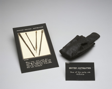 Photograph of Roman writing styli and shoe from the 1400s