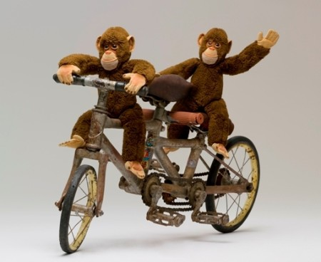 Tandem monkey bicycle with toy monkeys