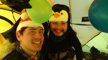 Photograph of James Castrission and Justin Jones celebrate Christmas in their thermal underwear during the Crossing the Ice Antarctic adventure, 2011.