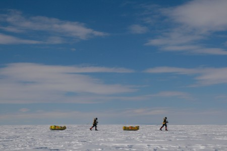 Photograph of Justin Jones and James Castrission hauling their sledges during the Crossing the Ice Antarctic expedition