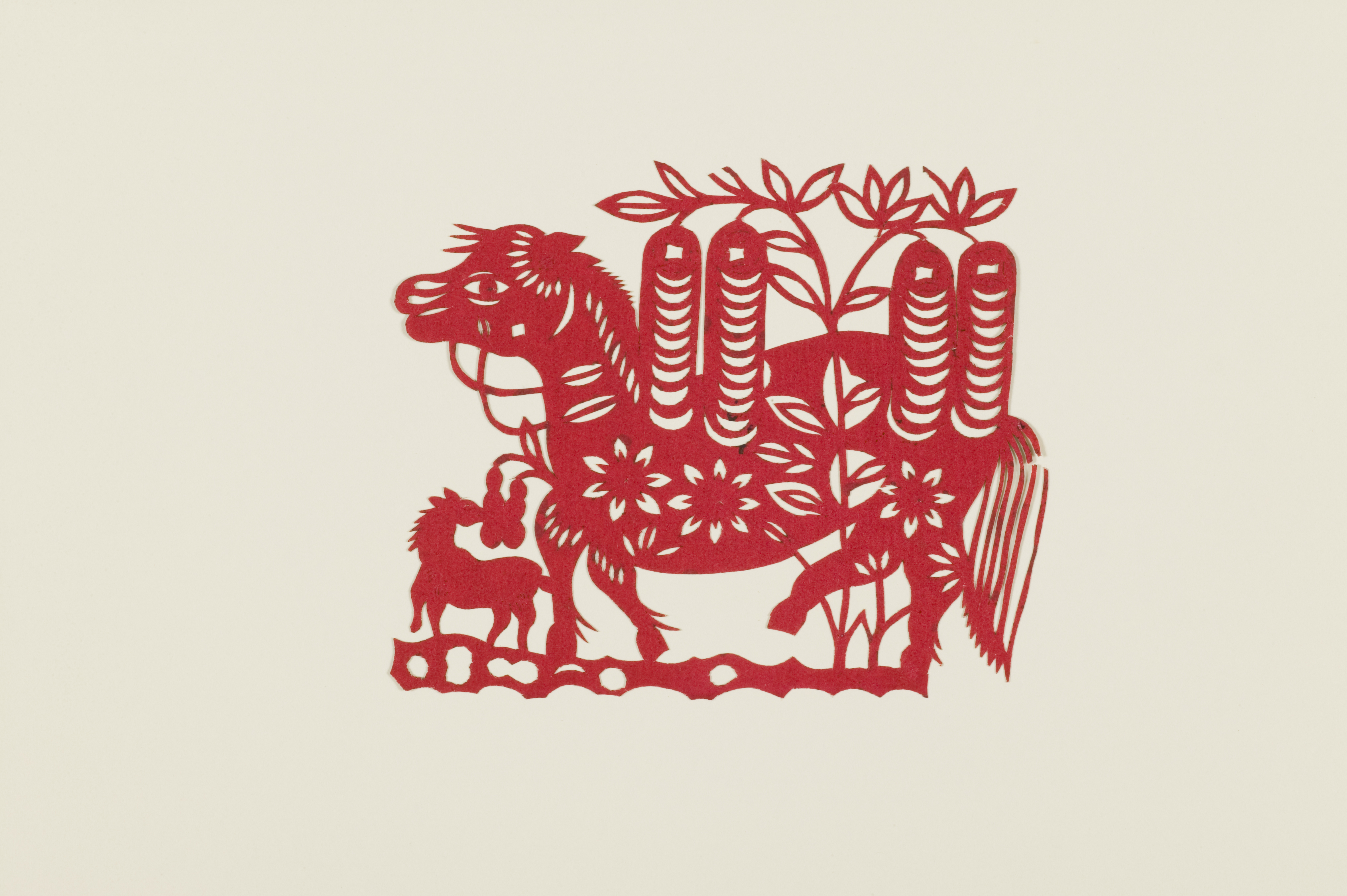 Photograph of red 'Precious horse shaking the money tree' Papercut