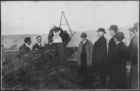 Photograph of Australia's first airmail flight being loaded