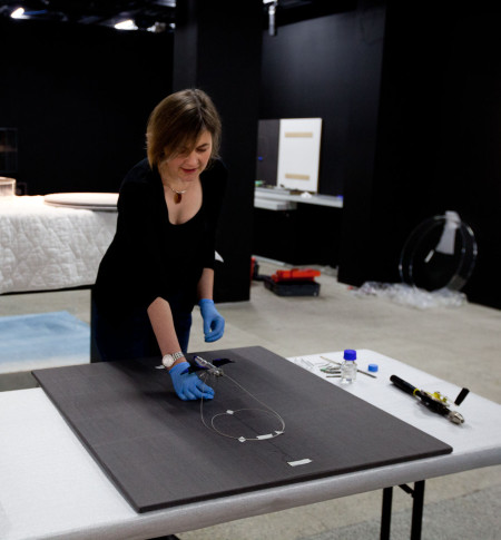 Conservator Rebecca Ellis working on the Susan Cohen piece for display. Image Marinco Kojdanovski Powerhouse Museum