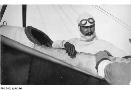 Maurice Guillaux sitting in his Blériot aircraft before a performance