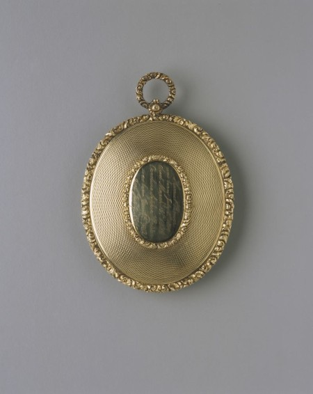 Underside of the mourning pendant showing the sisters names.