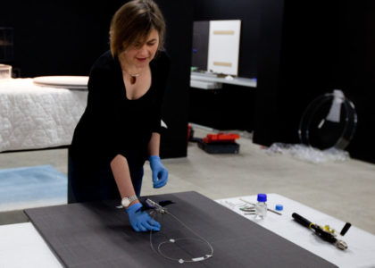Conservator Rebecca Ellis working on the Susan Cohen piece for display