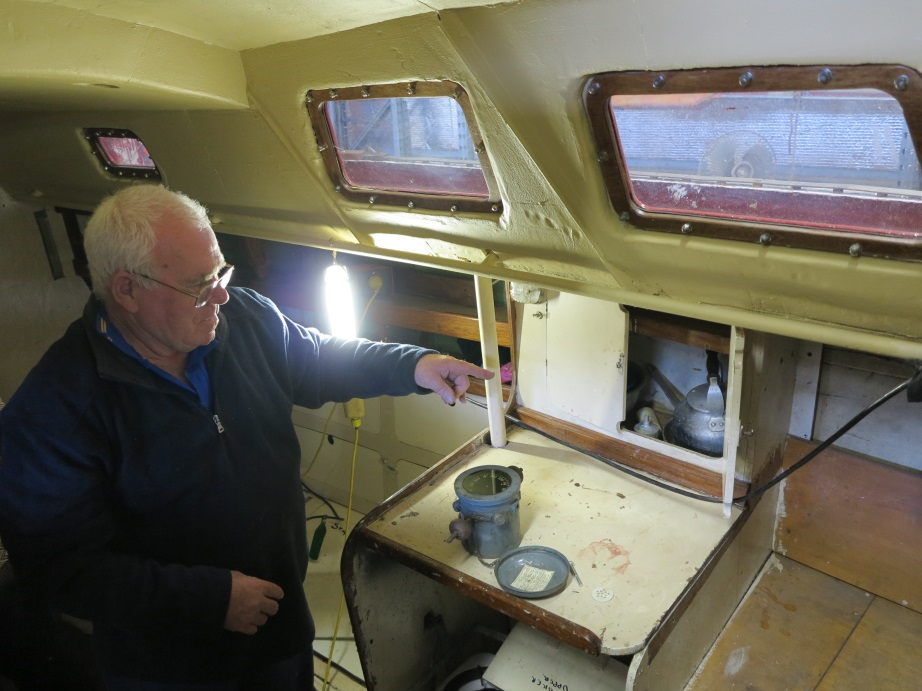A volunteer fitting out the cabin to circa 1973