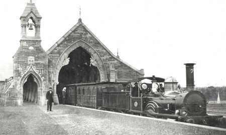 Locomotive No. 7 at the No.1 Mortuary Receiving Station at Rookwood Cemetery c. 1869. William Sixsmith might even be the bearded driver pictured on the footplate. The impressive Gothic-style building itself was removed stone-by-stone in 1958 and re-erected as All Saints Church of England, Canberra. Photo courtesy of State Records of NSW.