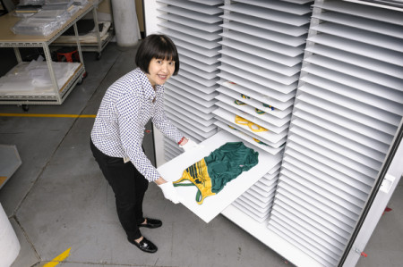 Conservator Suzanne Chee with the new low humidity chamber used to store swimsuits. Image: MAAS