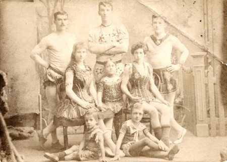 Photograph of Harry, Philip and George Wirth (standing); Marizles and Madeline Wirth (seated) with three child performers, Herbert, Carl and Alfred who were orphans adopted as Wirths. Gift of the Wirth family.