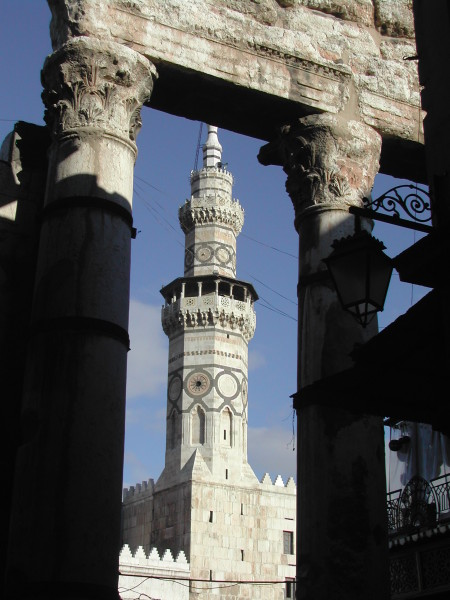 Umayyad mosque, the Minaret of Qaitbay (constructed 1488) seen between Roman columns at the end of the Souk Al-Hamidiyah, Old City, Damascus, 2003, photographer Paul Donnelly