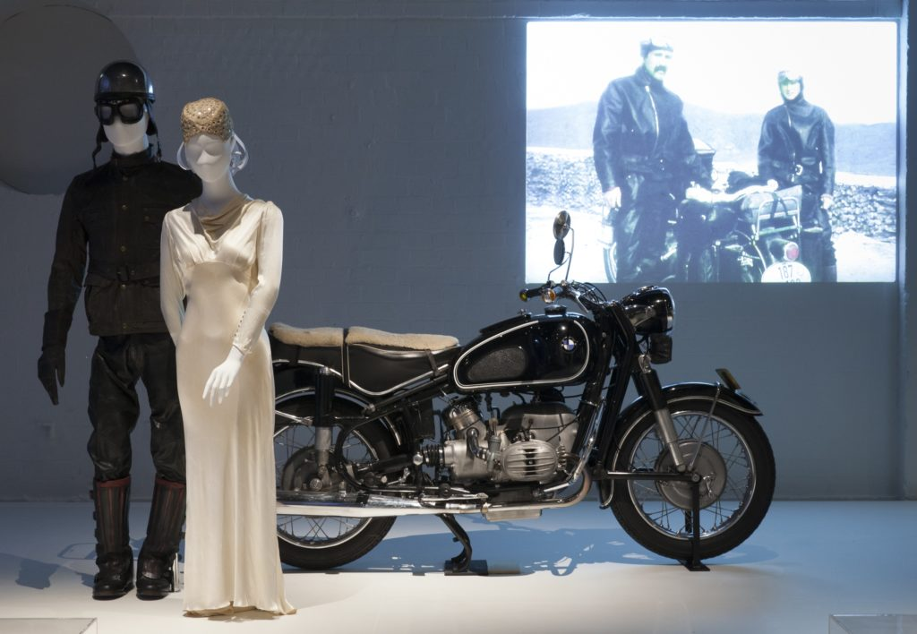 Mannequins of George and Charis Schwarz with their motorcycle on display in Love Is exhibition
