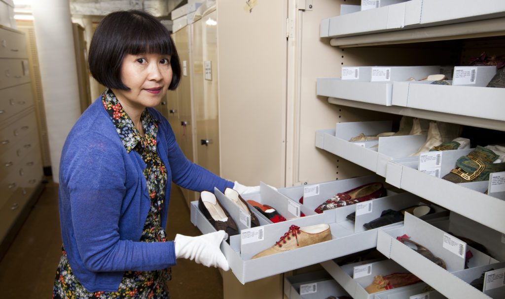 Conservator Suzanne Chee at work with shoe collection