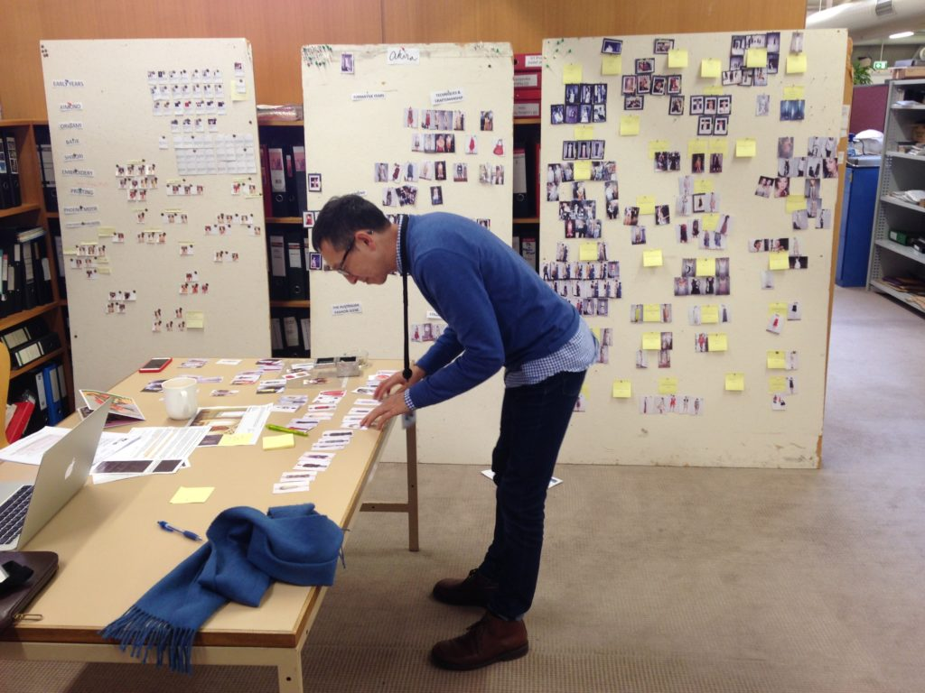 Senior Curator Roger Leong at work on a series of pin up boards