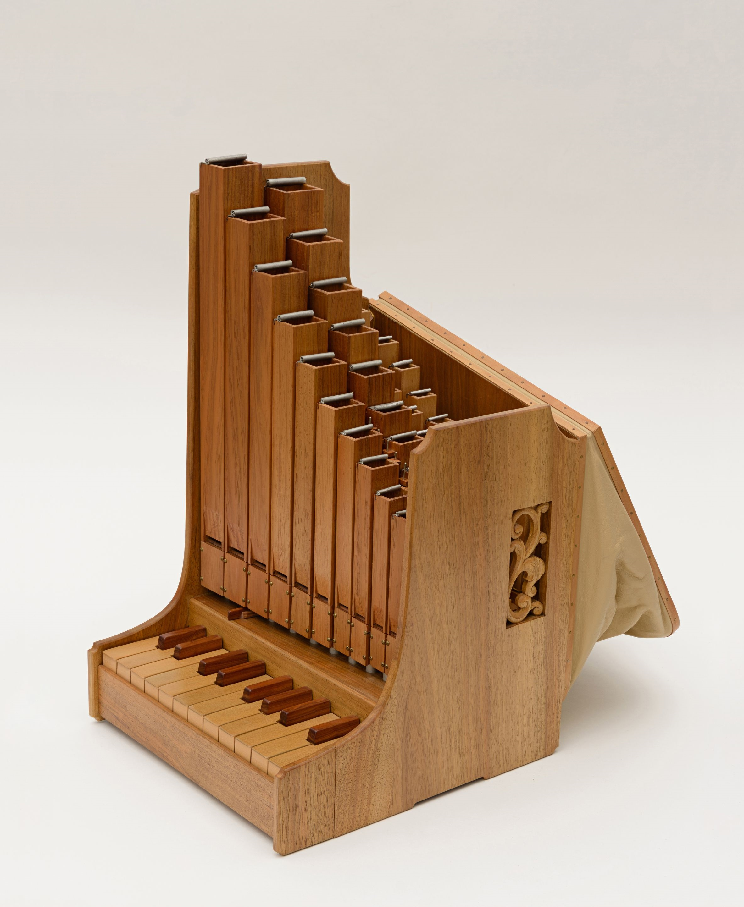 Image of a portative organ, from the side with bellows out.