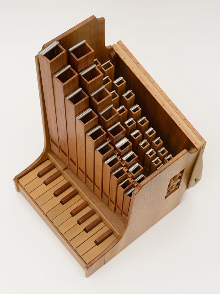 Photograph of a portative organ from above.