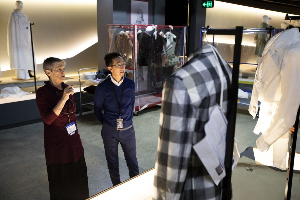 Kaye Spilker, Curator, Costume and Textiles (LACMA) and Roger Leong, Senior Curator (MAAS), deciding on the final positions