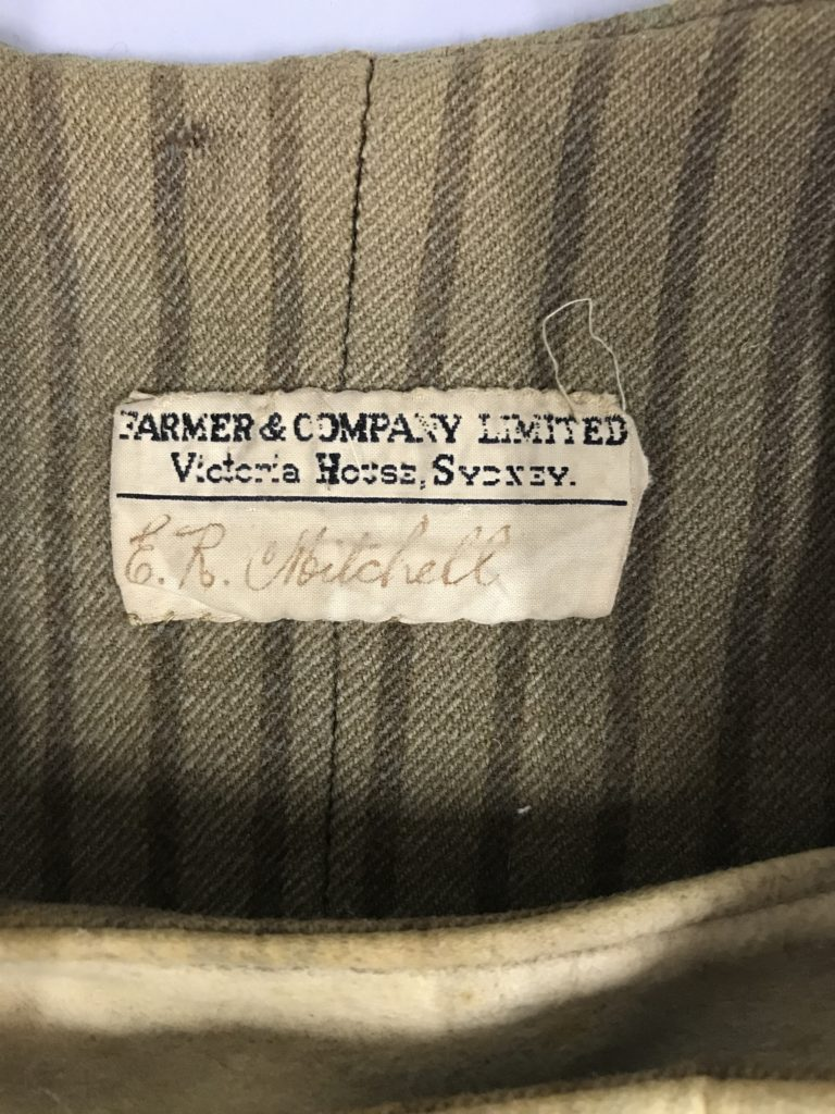 Close up of the manufacturer's label on the centre back vest interior. Reads E. R. Mitchell.