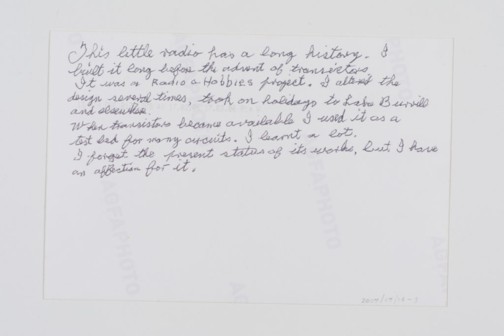Image of the reverse of David's snapshot with handwritten notes about his connection to the radio. Transcript given in the quote below.