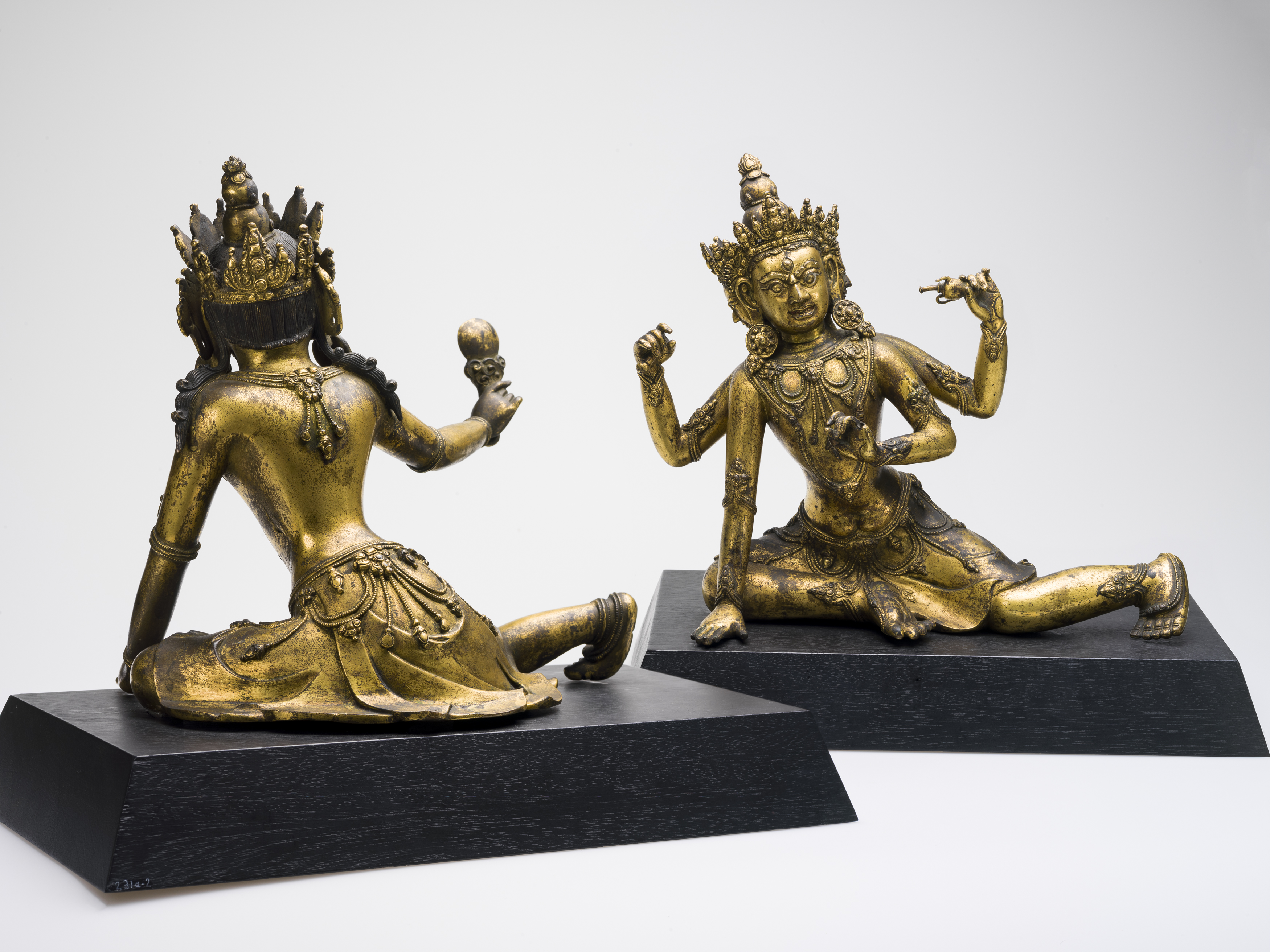 An image of two deity figures looking each other.