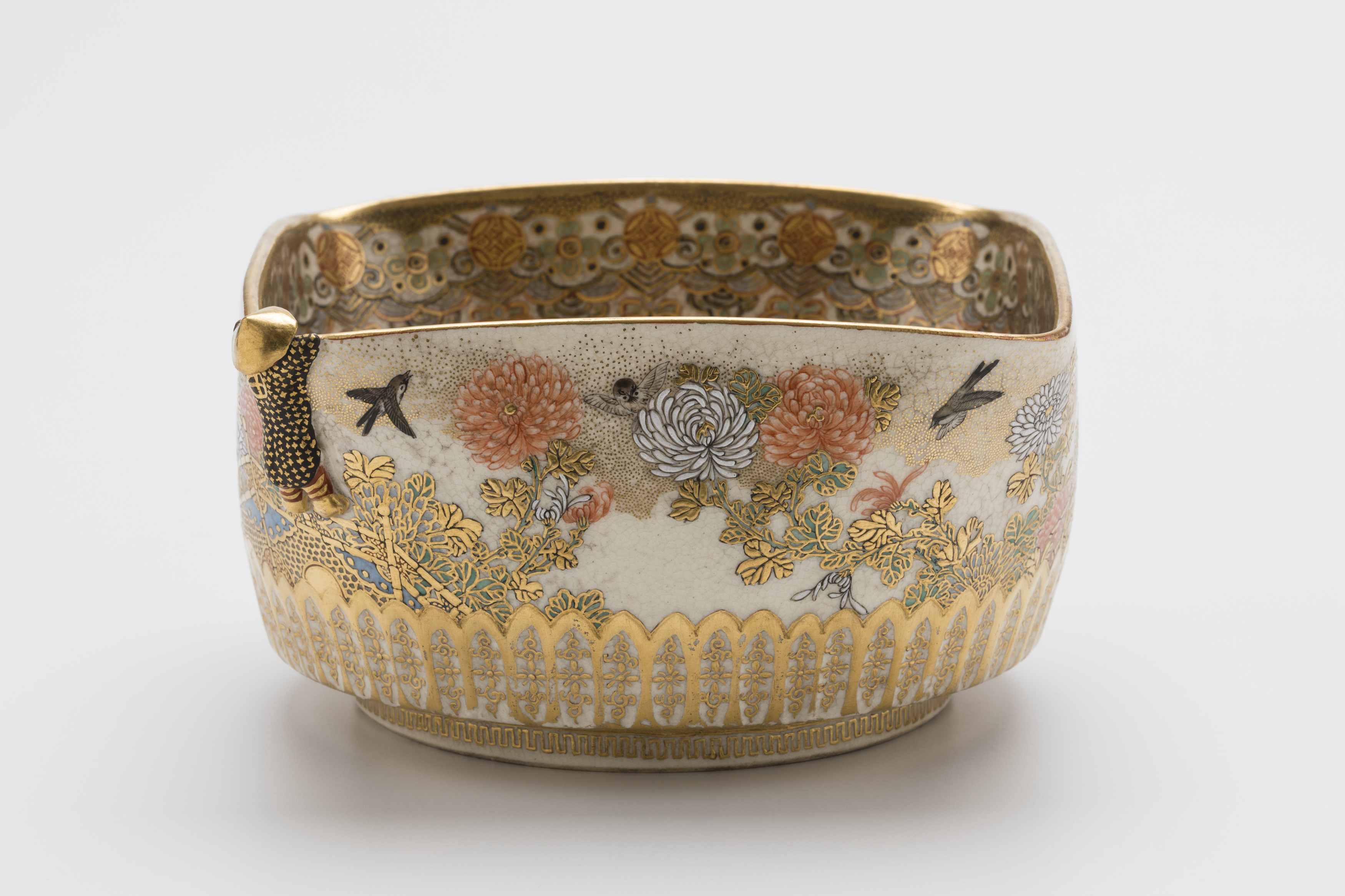 Single object image of a square shape bowl with gold decoration.