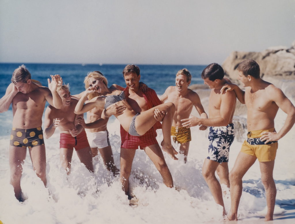 ec7b5e8b8 A staged colour photograph taken in the 1970s for advertising featuring  seven young men wearing board