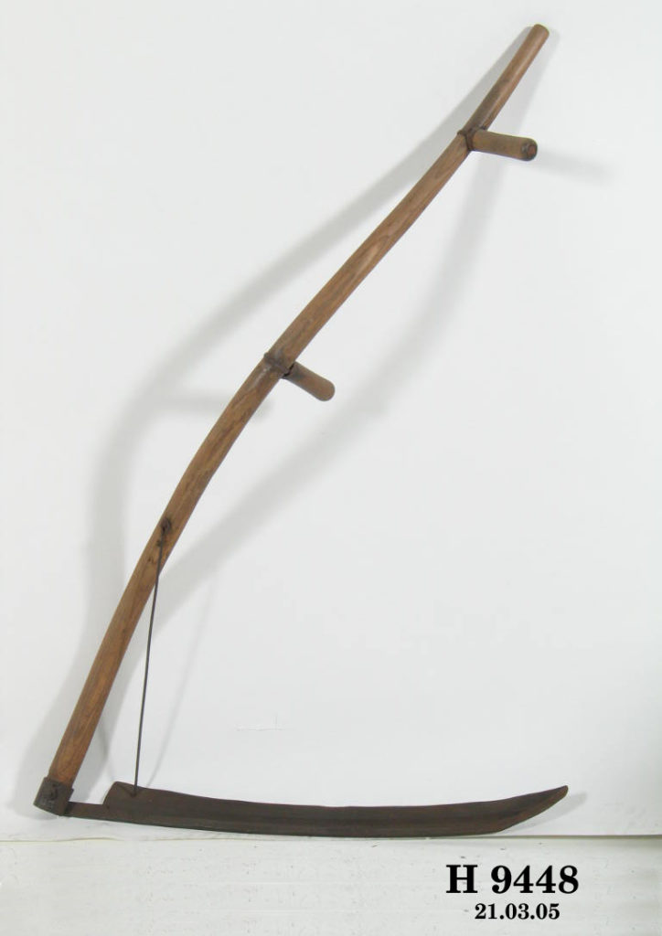 A hand tool with a long, curved timber shaft, two handles and a curved iron blade at one end.