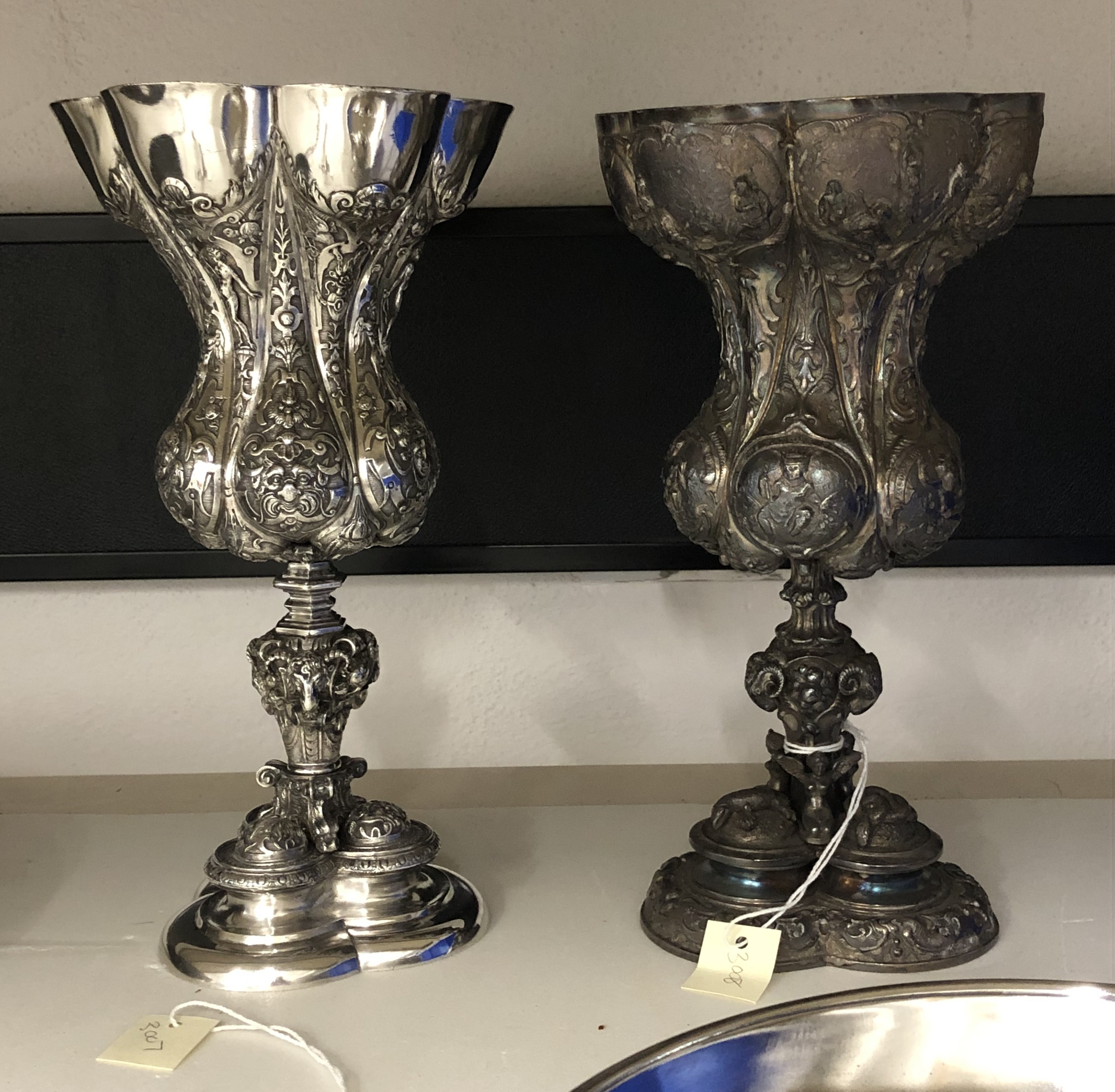 Two metal goblets side by side. The one on the left is polished and silver in colour, while the one on the right is heavily tarnished.