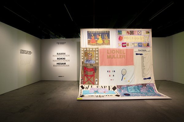 Installation view of the exhibition entrance featuring the Australian AIDS Memorial Quilt (MAAS Collection 2011/109/5).